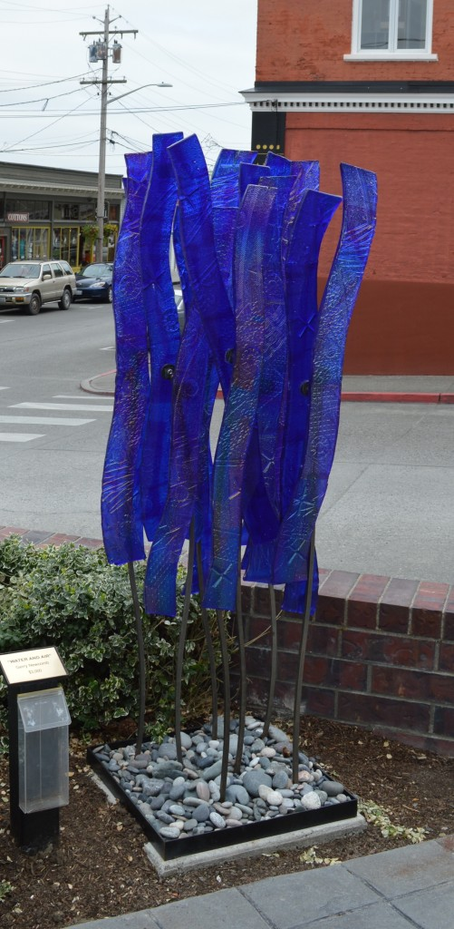 "54-glass and steel; appx 72"" tall x 22"" sq"